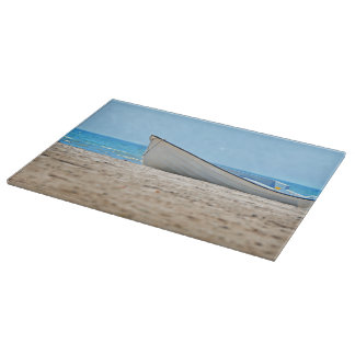 Boat at beach cutting board