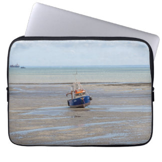 Boat at low tide laptop sleeve