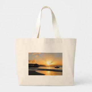 Boat at sunset large tote bag