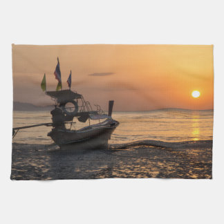 Boat at sunset on Pak Meng beach Tea Towel