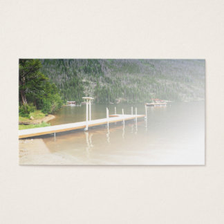 boat dock on a lake by a mountain business card