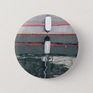 Boat fenders hanging on the board 6 cm round badge