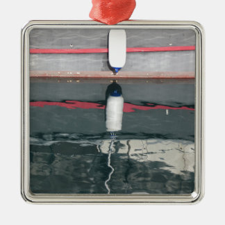 Boat fenders hanging on the board metal ornament