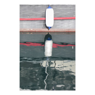 Boat fenders hanging on the board stationery