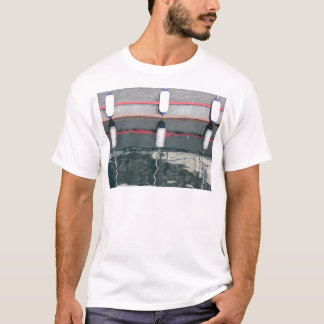 Boat fenders hanging on the board T-Shirt