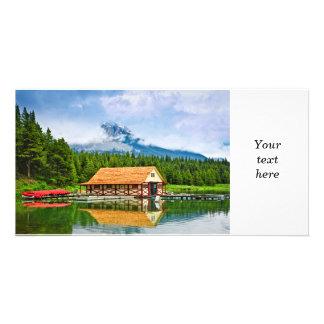 Boathouse on mountain lake photo card