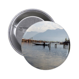Boatman on small wooden boat pinback buttons