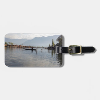 Boatman on small wooden boat luggage tags