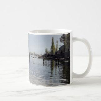 Boatman on small wooden boat mug