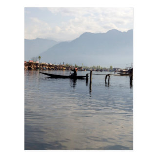 Boatman on small wooden boat postcard