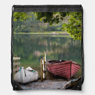 Boats along the shore of Buttermere Lake Drawstring Backpack