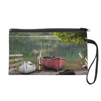 Boats along the shore of Buttermere Lake Wristlet Clutches