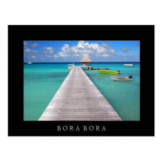 Boats at a jetty in Bora Bora black text postcard