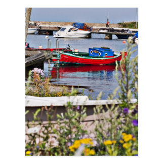 Boats docked in small harbor postcard