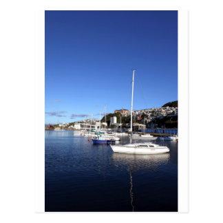 Boats in blue marina postcard