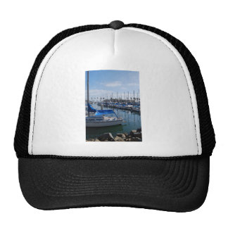 Boats in harbor cap