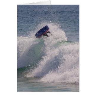 Body boarder riding a big wave greeting card