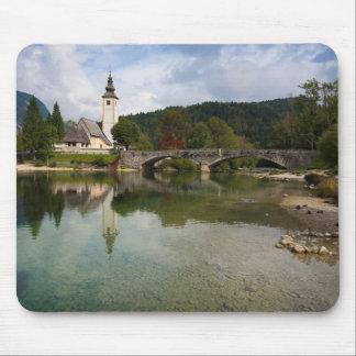 Bohinj lake with church in Slovenia mousepad
