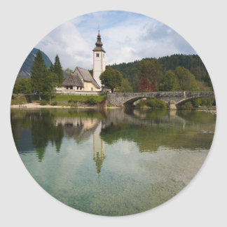 Bohinj lake with church in Slovenia round sticker