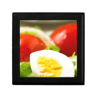 Boiled egg on a plate with lettuce, onions gift box