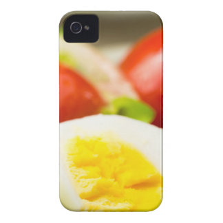 Boiled egg on a plate with lettuce, onions iPhone 4 cover
