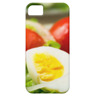 Boiled egg on a plate with lettuce, onions iPhone 5 cover