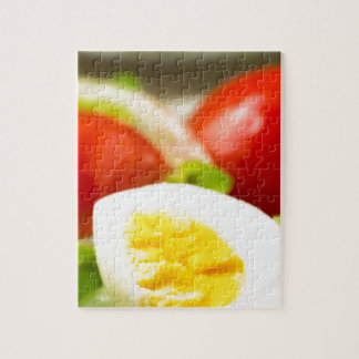 Boiled egg on a plate with lettuce, onions jigsaw puzzle