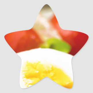 Boiled egg on a plate with lettuce, onions star sticker