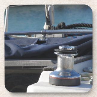 Bollard and mooring ropes on sailing boat bow coaster