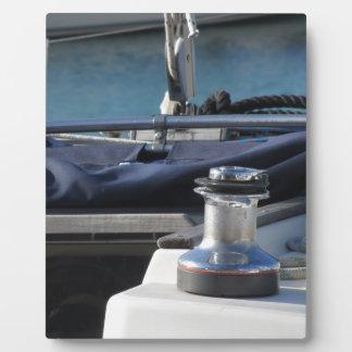 Bollard and mooring ropes on sailing boat bow plaque