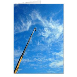Boom of the crane on a diagonal against a blue sky card