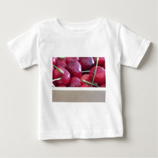 Border of fresh cherries on wooden background baby T-Shirt
