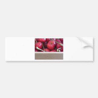 Border of fresh cherries on wooden background bumper sticker