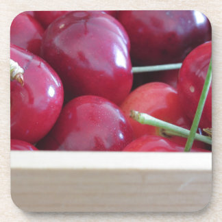 Border of fresh cherries on wooden background coasters