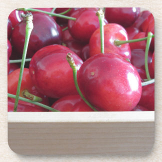 Border of fresh cherries on wooden background drink coasters