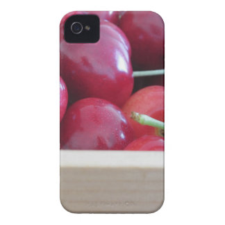 Border of fresh cherries on wooden background iPhone 4 cover