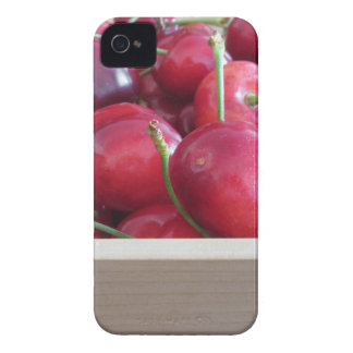 Border of fresh cherries on wooden background iPhone 4 covers