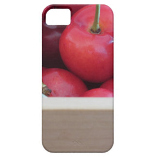 Border of fresh cherries on wooden background iPhone 5 cover