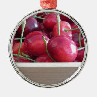 Border of fresh cherries on wooden background metal ornament