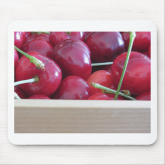 Border of fresh cherries on wooden background mouse pad
