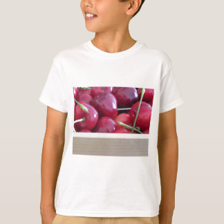 Border of fresh cherries on wooden background T-Shirt