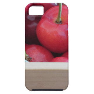 Border of fresh cherries on wooden background tough iPhone 5 case