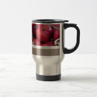 Border of fresh cherries on wooden background travel mug