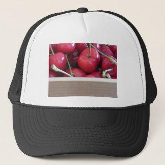 Border of fresh cherries on wooden background trucker hat