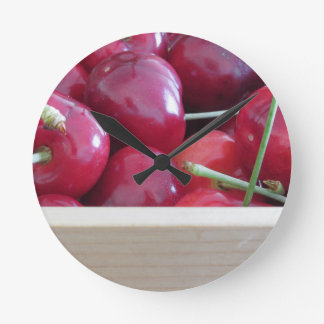 Border of fresh cherries on wooden background wall clocks