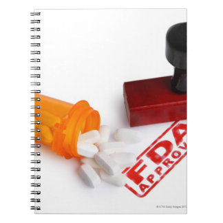 Bottle of Pills and a FDA APPROVED rubber stamp Notebook
