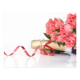 bottle off champagne and pink flowers post card