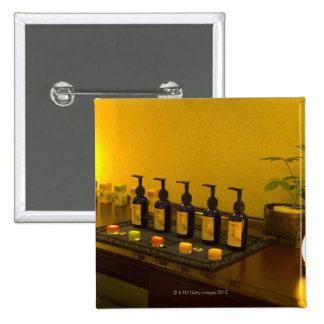 Bottles of aromatherapy oil in the beauty salon, 15 cm square badge