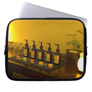 Bottles of aromatherapy oil in the beauty salon, laptop sleeve