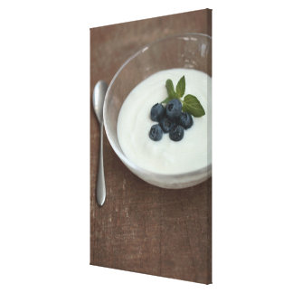 Bowl of yoghurt with blueberry on table gallery wrapped canvas